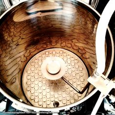 Stainless steel homebrewing mash tun with a sparge arm. Used to drain the sugars…