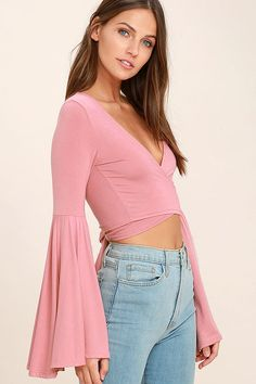 The Tender Touch Blush Pink Long Sleeve Crop Top is so trendy it's giving us goosebumps! Soft jersey knit sweeps across a cropped, square-cut bodice with a sexy open front and tying waist. Long bell sleeves.