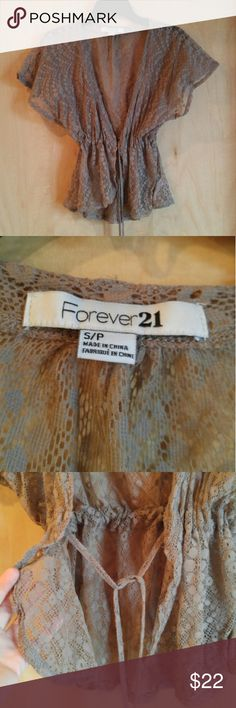 Forever 21 Brown Lace Short Sleeve Cardigan Wrap Forever 21 cardigan, size small, in excellent condition! All lace brown front tie wrap. Flutter sleeves. Adjustable tie waist. Dainty and thin. Would be perfect to wear over a dress! Please ask any questions. No trades. Make a reasonable offer. Thanks! Forever 21 Tops Blouses
