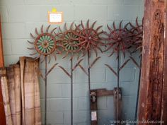 Do you know what plow disc flowers are? I didn't either until I spotted some a couple of years ago. The flowers are funky garden art from reclaimed discs. Nashville Flea Market junkin' trips with Petticoat Junktion. Taking photos of my favorite things.