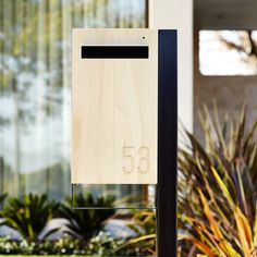 Modern Custom Mailbox Javi Post Mount Letterbox Charcoal Aluminium Body Post Stainless Steel Visor and Hardware Timber front briefkasten Custom Mailboxes, Modern Mailbox, Door Latch, Post Box, Dark Stains, House Numbers, Wood Paneling, Aluminium, Signage