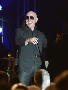 Pitbull Photos - Pitbull performs at the   Destination Fashion 2016 to benefit The Buoniconti Fund to Cure Paralysis, the fundraising arm of The Miami Project to Cure Paralysis at Bal Harbour Shops on March 5, 2016 in Miami, Florida. - Destination Fashion 2016