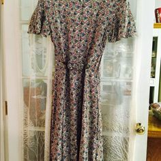 "Vtg:2/ $ 12.00💥long sun dress Red and blue tiny flower design long sun dress.100% Rayon, size 10.With detachable covered clip with the same material , for adjusting the waist line to a desire fitting. To added up beauty to the neckline ,3 hand made flowers made of the same material  attached to it .Umbrella cut sleeves. Waist line going first hip measured 38-1/2"".  51"" long. Zipper at the back. Dresses Maxi"