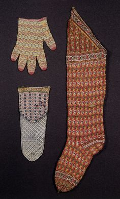 Pair of men's socks with short leg and white ground. IM.147&A-1926.   V&A Museum. On the lower left. Heel and sole visible in this shot.