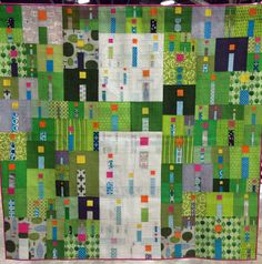 """i Quilt by Kathy York of Austin, Texas.  This quilt won Best in Show and it is gloriously vibrant – I love it.  In her description of her quilt, Kathy wrote… """"At times I feel alone, but I am not.  I am supported by many friends and family.  These are the little """"i"""" blocks that make up the big central """"i"""".  The other """"i"""" blocks in the field are for all the people I have never met that support my life."""""""