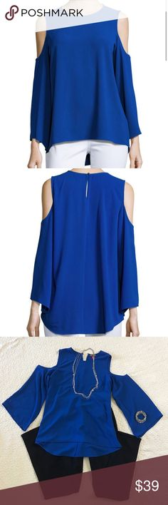 Vince Camuto Blouse Vince Camuto cold shoulder Blouse with jewel neck. Bell sleeves. Back keyhole with button closure. 98% polyester and 2% elastane. Bold cobalt color. Size small. Vince Camuto Tops Blouses