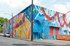 SPACE SHIFTS: Local artist HENSE painted the exterior of the new WCAC.