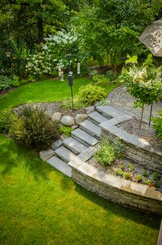 McKay Nursery Company designed and landscaped this customer's backyard. Private, shaded garden with beautiful flowers, trees, hardscape stairs and patio.