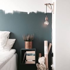 Such a beautiful bedroom painted by moeofsweden at Instagram. The wall is painted in the color Petroleum 790 from Beckers.