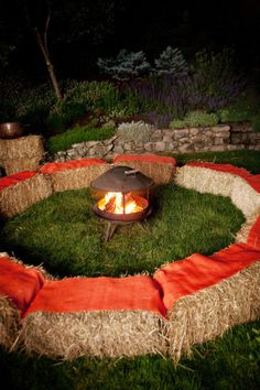 Fire pit with hay bale seating for an outdoor fall wedding