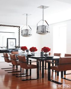 In Ralph and Ricky Lauren's Manhattan dining room, vintage light fixtures hang above a table and leather-upholstered chairs by Ralph Lauren Home; the custom-made zebra-skin mirror is by Richomme.     Photographer: William Abranowicz   Homeowner: Ralph and Ricky Lauren   Featured in: Ralph Lauren's Chic Retreat   Issue: October 2010