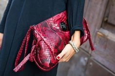 a snake skin bag will always spruce up any outfit, especially in an eye catching color like this beautiful red