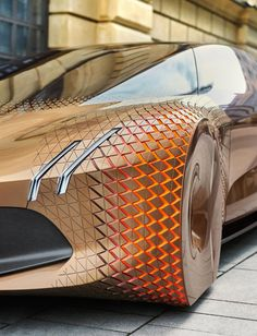 BMW turns 100 this year, and although the company has a rich history, it is looking forward with a barrage of extreme concepts to prove its will remain relevant for the next 100 years. The company owns Rolls-Royce, which recently offered a glimpse of luxury in the 22nd Century, and Mini, which got a futuristic makeover. And now BMW peers into tomorrow and sees a sleek four-door with flexible skin, scissor doors, and an interior that flutters in three dimensions to communicate with you.
