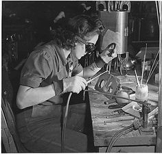 A woman welder at the Inglewood, Calif. plant of North American Aviation works on a sub-assembly for one of the huge tanks that go into B-25 bombers., 10/1942