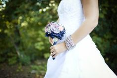 Dainty and cute brooch bouquet done in blue satin wrap with Mothers brooch on stem as a way to incorporate her into the day! Created by The Bouquet House Inc. WEDDING BOUQUET $ 450 CAD