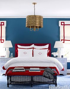This large guest room in a Charlotte, North Carolina, house, needed graphic punch. Designer Lindsay Coral Harper started with the Stark carpet, and ended with the Greek Key pendant light from C. Bell. Walls are painted Benjamin Moore's Van Deusen Blue. Vintage nightstands are from Liza Sherman; Julia B. bedding.   - HouseBeautiful.com