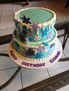 Disney frozen cake themed - blue, purple and lavender marble cake covered with buttercream and fondant icicles. Made by Sweets by Josie.