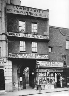 Unseen Vintage Photographs of a Lost London, ca. Evans and Witt, Stationers and Bookbinders, Booksellers and Tobacconists, ca. Victorian London, Vintage London, Old London, Victorian Street, Victorian Era, Vintage Shops, London Pride, London History, British History