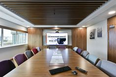 Conference Room | A technical presentation system is the main focal point in the conference room, giving users the ability to view content from many different sources. Audio and video conferencing is taken care of by a Polycom system with a discrete ceiling pendant microphone over the table. Lutron lighting control and motorised window treatments, along with all audio-visual technologies, can be controlled via an RTI handheld remote control handset and wall keypad.