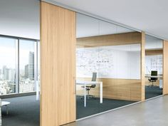 Glass office walls with wood dividers and door