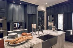 dark cabinets kitchen - I like the stainless sink too!