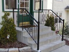 Iron step railing with 2 inch square end posts and square casting designs.