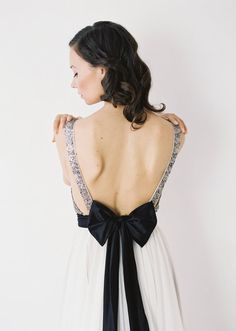 This gown features a plunging neckline, open sides, and a striking back. The skirt is made of 10 yards of hand-draped chiffon, which catches movement and the wind perfectly. The sequined bodice and off-white chiffon skirt is tied together beautifully with a silk bow that is both elegant and dramatic.</p> <p>This dress works best for girls with a smaller chest (no …</p>