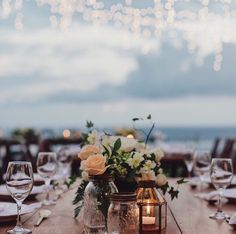 Beach wedding #candles #flowers #beachwedding