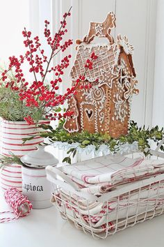 Decorating for Christmas with a gingerbread house and red and white