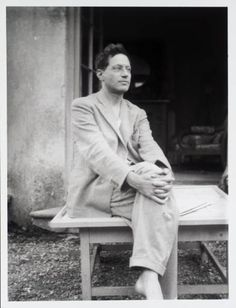 Description: Photograph of Duncan Grant in the garden outside the drawing room of Charleston farmhouse, the house he shared with Vanessa Bell.
