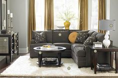 About to get a gray couch...wanna bring some color in. Love the pop of gold.