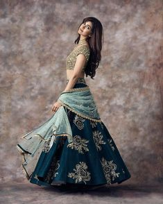 Stunning peacock blue color designer lehenga and gold sequence blouse with ice blue color net dupatta. Designer Bridal Lehenga, Indian Bridal Lehenga, Indian Bridal Outfits, Indian Designer Outfits, Designer Lehanga, Choli Designs, Lehenga Designs, Lehnga Dress, Indian Gowns Dresses