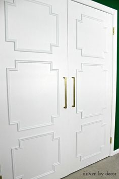 Update Your Closet with this Flat Panel Door Makeover! Ugly flat closet doors made current and stylish with the addition of simple panel molding in a geometric design Decor, Driven By Decor, Bifold Doors, Painted Doors, Closet Door Makeover, Diy Molding, Diy Door, Door Makeover Diy, Doors Interior