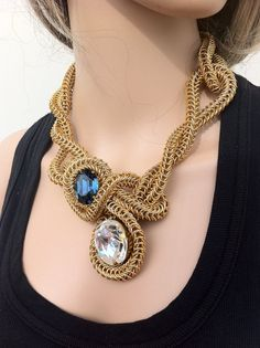 Statement Necklace, Avant-Garde Chain Maille. This piece is nothing short of amazing.  I would love to try it, just to see how comfortable it is.  But then who cares, its the perfect necklace for those on the edge.