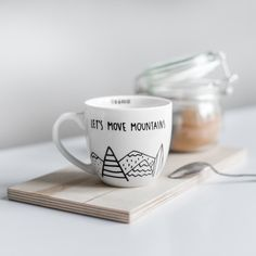 White originally designed and hand-painted mug for tea or coffee. PATTERN: LET'S MOVE MOUNTAINS  volume 300ml ↔ width 9cm + ear 3cm ↕ height 9cm  cap diameter 11cm  The product is sold without tea infuser.   Decorate your kitchen and get creative with the kitchen accosseries. FOR.REST equals min...