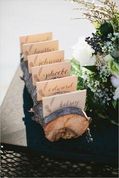 wooden log escort card display #diyescortcards #escortcards #weddingchicks http://www.weddingchicks.com/2014/03/28/organic-rooftop-sunset-wedding/