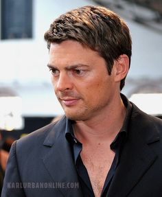 "From Karl Urban International (edits by me) - We have other images from this ST premiere, all of which could be collectively known as the ""Karl Looking Dreamy in that Black-on-Black Ensemble and Showing an Even Greater Allergy to Buttons than Usual"" series. But I've never seen this one before. Be sure and click to see it in its high-res, up-close-and-personal beauty. Dayum!"