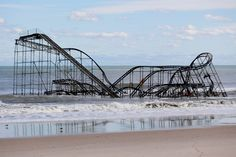 A rollercoaster that once sat on the Funtown Pier in Seaside Heights, N.J., rests in the ocean, Oct. 31, 2012, after the pier was washed away when superstorm Sandy made landfall. (Julio Cortez/Associated Press)#