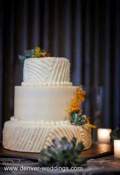 contemporary wedding cake with succulents