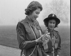 ©British Pathé.The Guiding Princess.  Princesses Elizabeth and her sister Princess Margaret in Girl Guide uniforms. Elizabeth writes a goodwill message which she dispatches by pigeon.