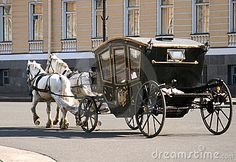 horses-pulling- enclosed carriage