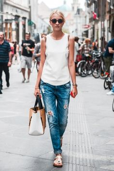 simple outfit with destroyed jeans and white tank