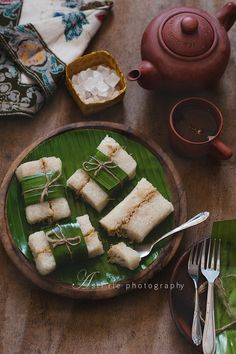 Lemper Ayam. Indonesian snack of sticky glutinous rice filled with chicken and wrapped in banana leaves.