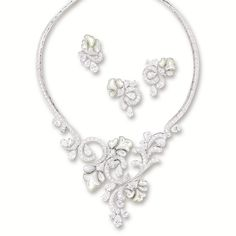 DIAMOND AND MOTHER-OF-PEARL 'ROMANTIC FLOWERS' DEMI-PARURE, Van Cleef & Arpels The articulated necklace decorated to the front with brilliant-cut diamond-set scrolls extending to the back, highlighted by mother-of-pearl flower heads and pear-shaped diamonds; and pair of earrings and ring en suite; the diamonds altogether weighing approximately 35.00 carats, mounted in 18 karat white gold.