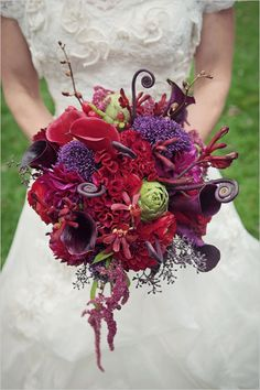 red wedding bouquet. i spy an artichoke.