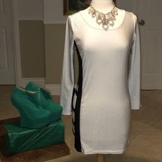 White, black, and turquoise dress White, black, and turquoise mini dress with cut out design on side of dress and 1 sleeve (as shown in pics). Thin stretchy material, fitted dress. Necklace and shoes sold separately. Brass Candy Dresses Mini
