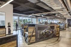Custom WorkStations with Blackend Steel and Reclaimed Wood and Changeable Graphic for Monster Energy | Interior Design by H.Hendy Assoicates