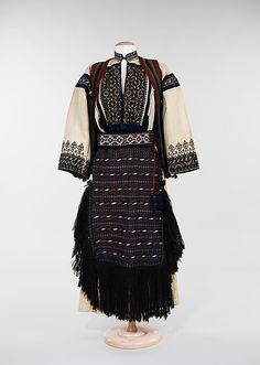 "This 1934 ensemble, comprised of dress, vest, apron, and belt, is unusual in its completeness and variety of elements. The culture is identified as Yugoslavian. The name (which means ""land of south Slavs"") was formally adopted in 1929 for the post-World War I Balkan region known as the Kingdom of Serbs, Croats, and Slovenes."