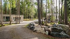 Villa K's angular concrete volumes provide views of a Finnish forest