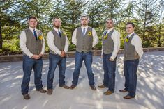 Groom/Groomsmen Attire: Wrangler Jeans, Tweed Vest (Tuxedos of Lodi), Boots, Navy Blue Ties, Pocket Watches